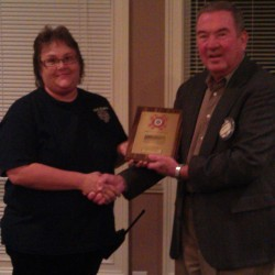 Susan Jackson is honored for her service as a volunteer firefighter.