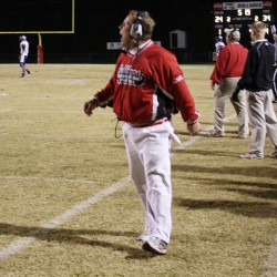 Offensive Coordinator Tony Lundy calls in a play in Cedartown's 46-32 victory. (Gail Conner/ camerachik.com)