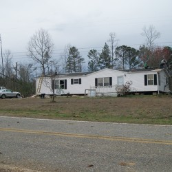 A home in Haralson County that sustained roof damage, and broken windows.